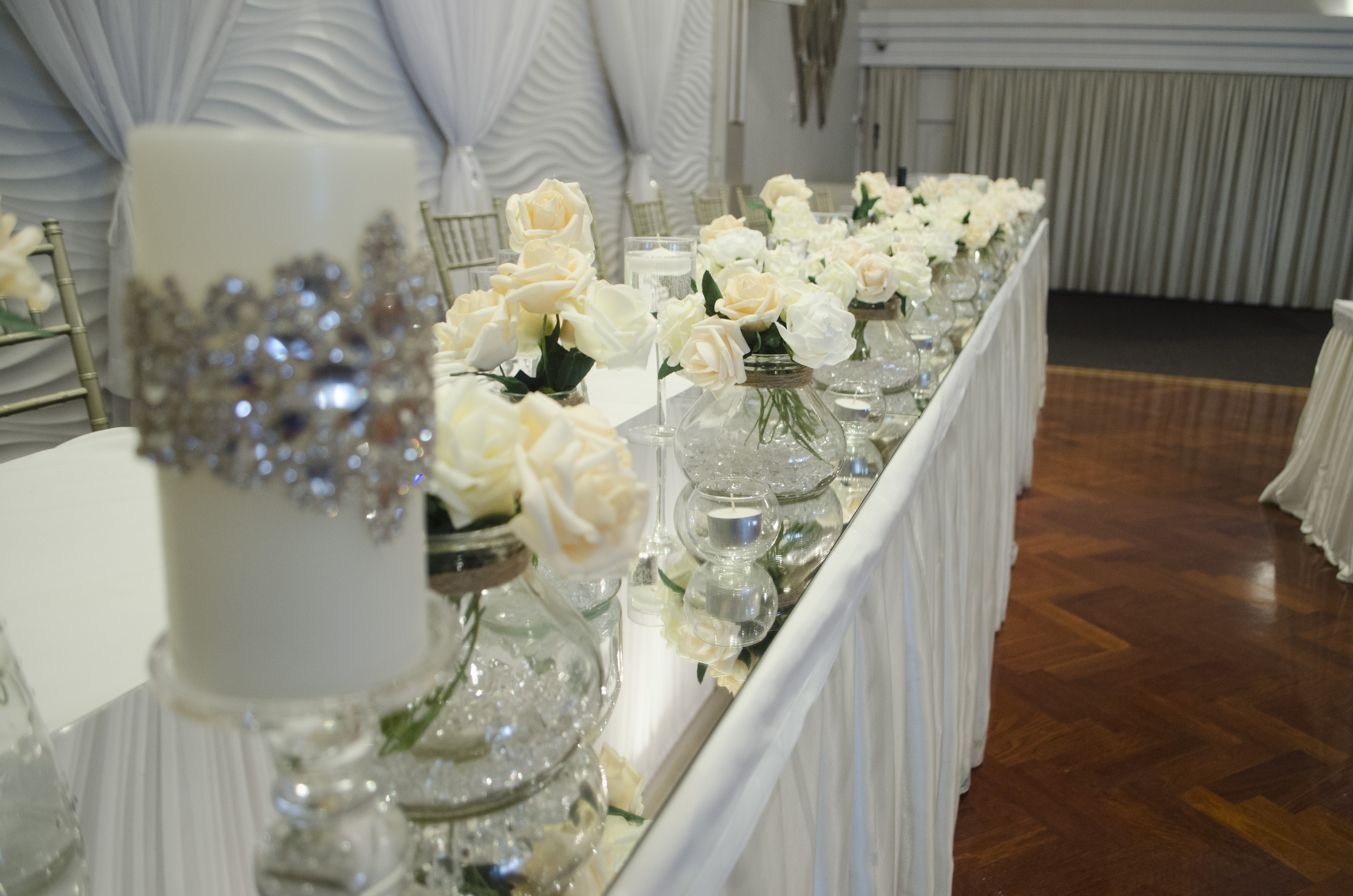 Layered vases with Real Touch Roses and Encrusted Swarovski Beaded Candles at Novella Events 4