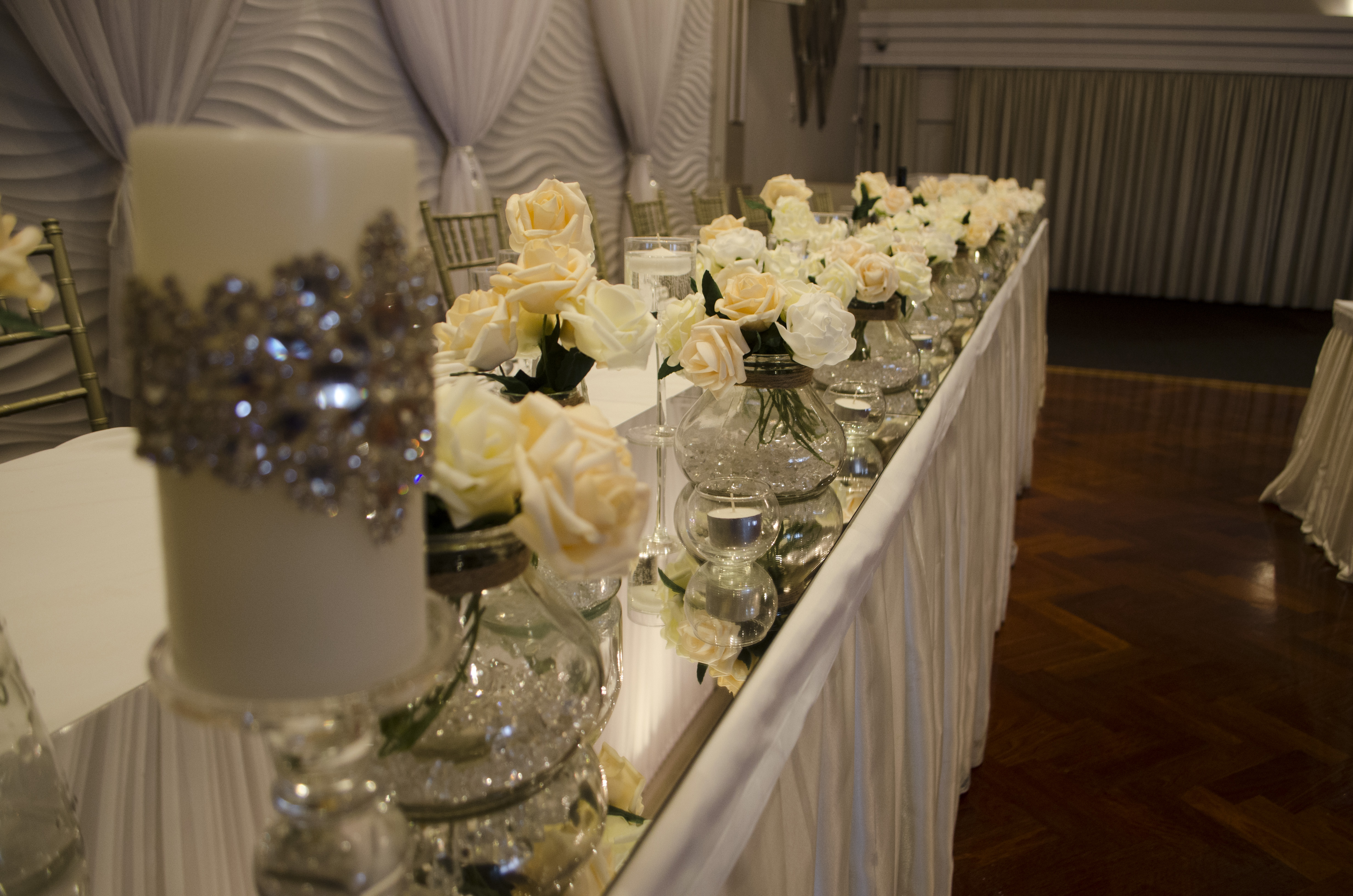 Layered vases with Real Touch Roses and Encrusted Swarovski beaded Candles at Novella Events 3