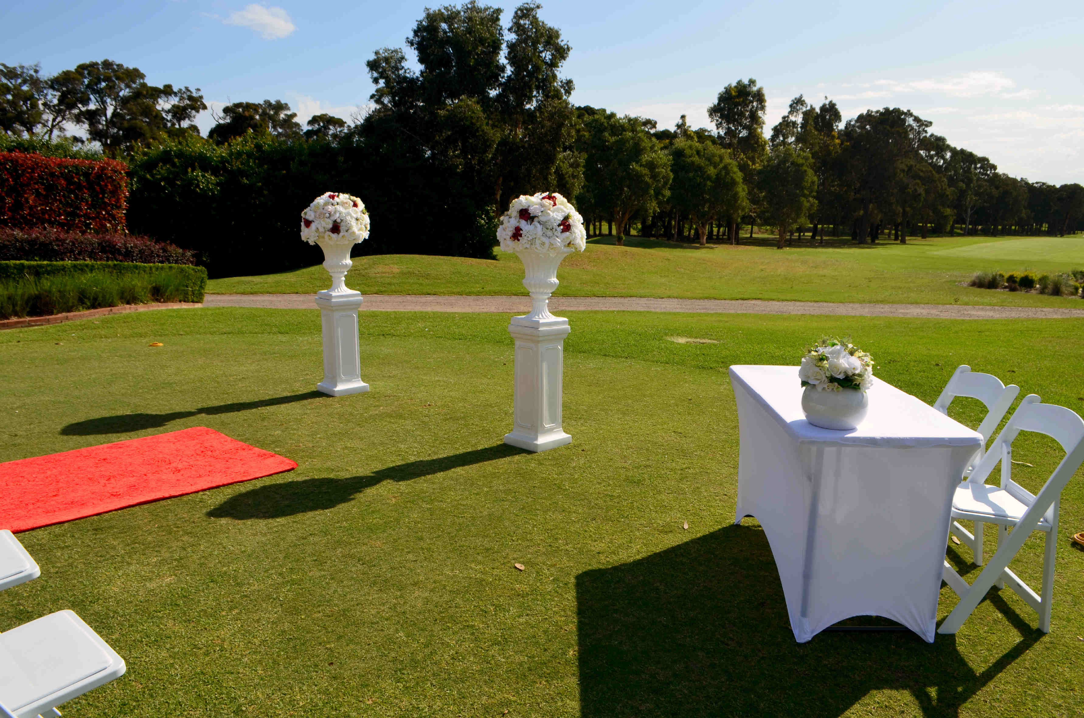 White pedestal and Urn with large artificial flower topper and Signing table 1
