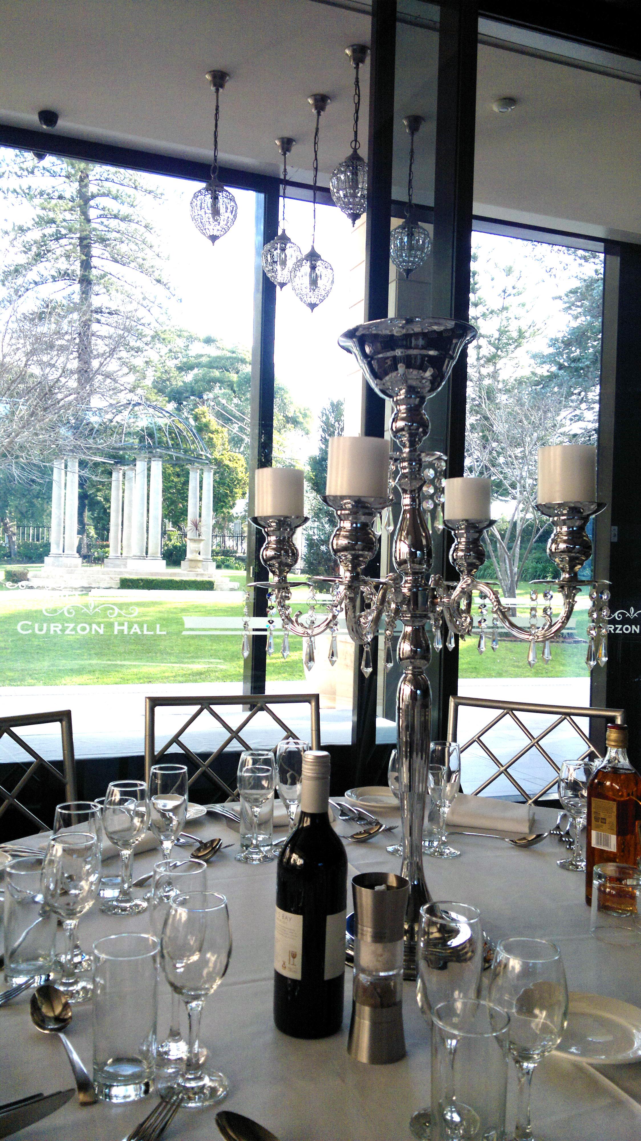Chrome 5 arm candelabra at Curzon Hall 1