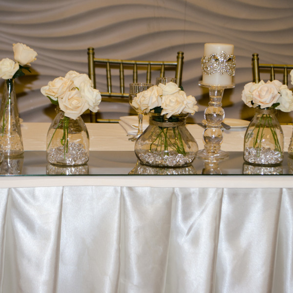 Layered vases with real touch roses and swarovski beaded candles at Novella Events 1