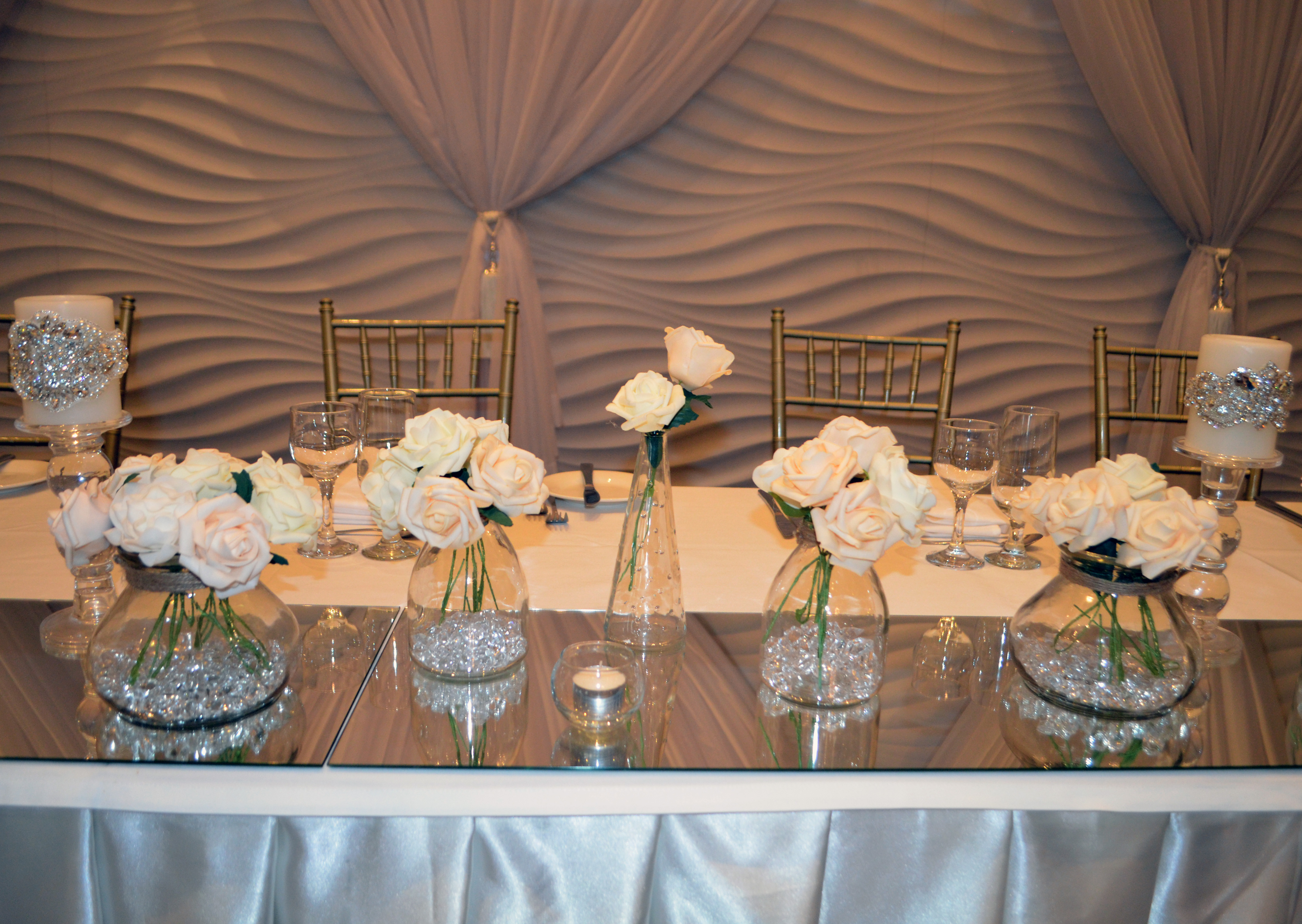 Layered vases with real touch roses and swarovski beaded candles at Novella Events 2