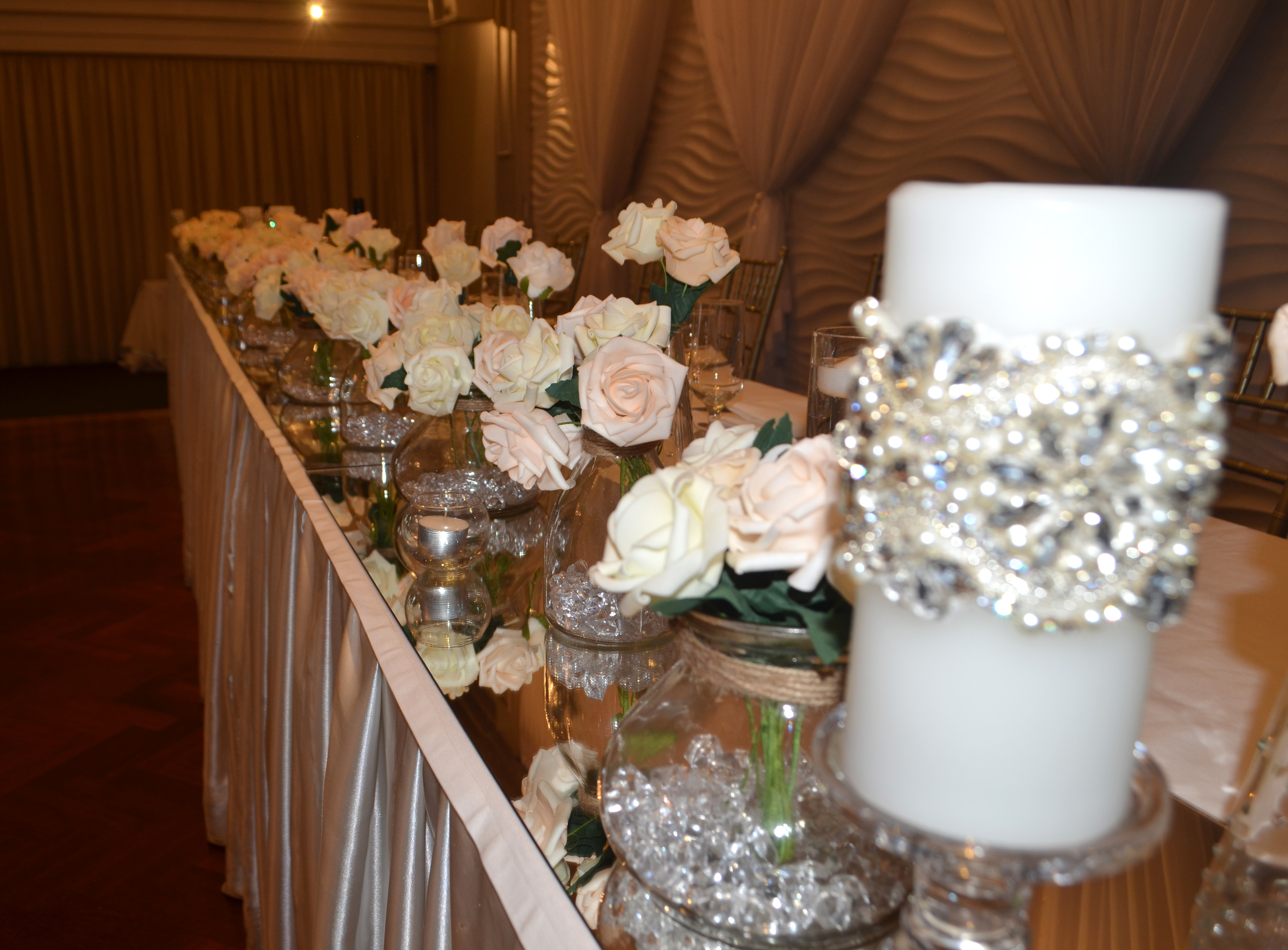 Layered vases with real touch roses and swarovski encrusted candles at Novella Events 3