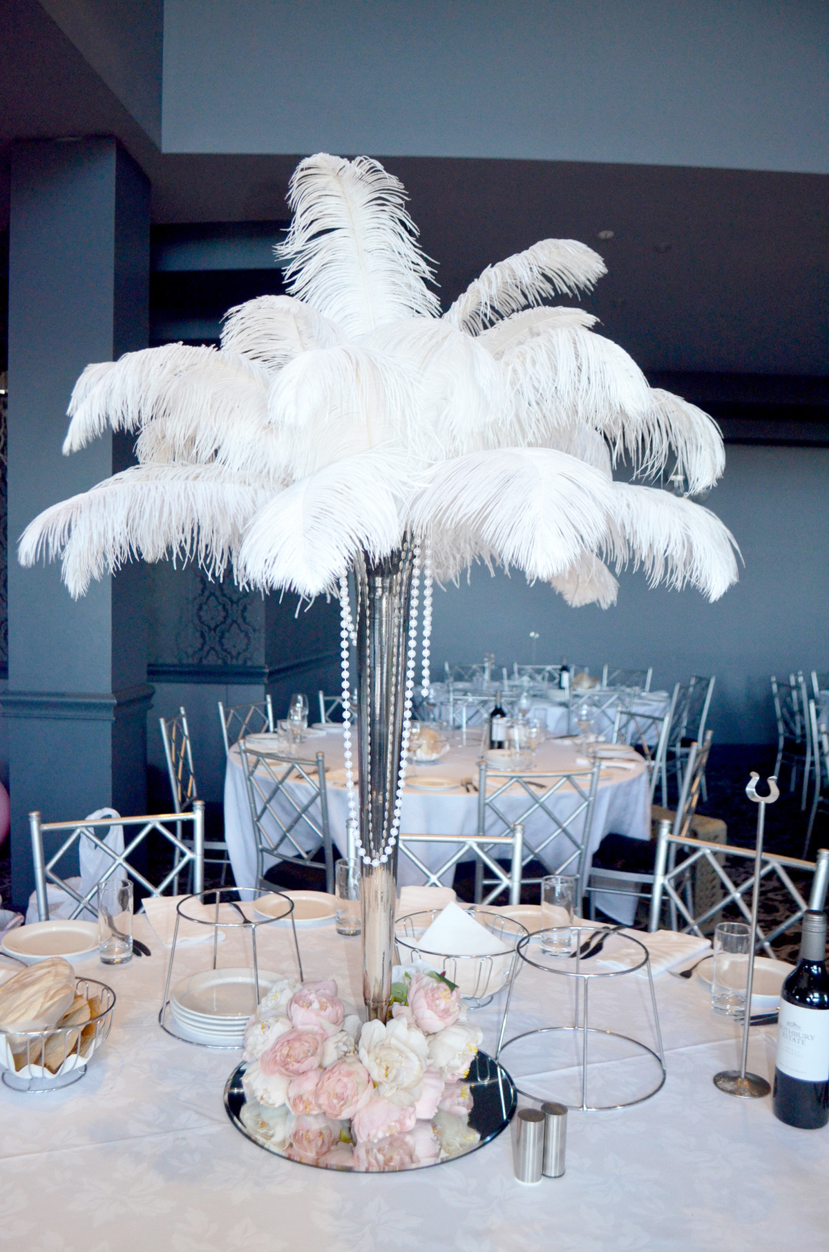 Silver vase with white ostrich feathers and artificial peonys silver vase with white ostrich feathers and artificial peonys reviewsmspy